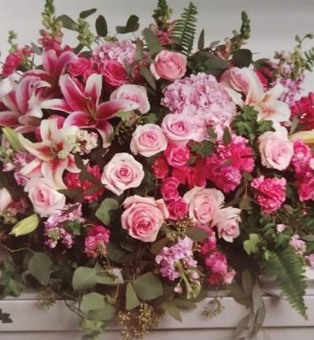 Flower All In Blooms Florist flowers on casket Roses